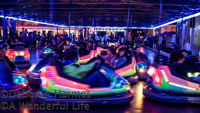 The bumper cars ride at a night carnival in St. Girons, Midi-Pyrenees, France