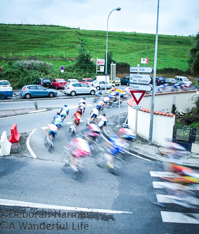 Cyclists on a night-time road race in St. Girons in the Midi-Pyrenees in France