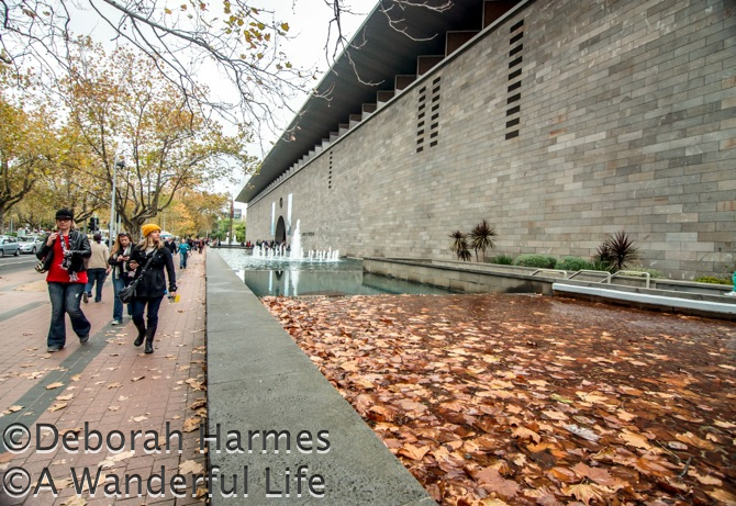 Autumn leaves falling outside the NGV art museum in Melbourne, Australia