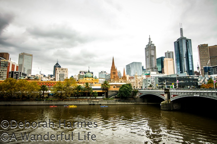Glistening even on a gloomy autumn day, a partial skyline view of Melbourne, Australia across the Yarra River from Southgate.